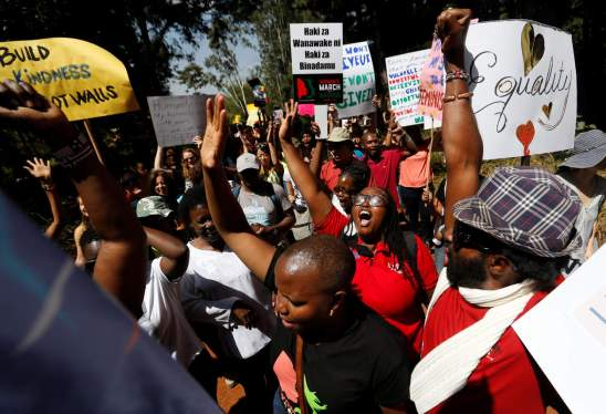 Demonstrators protest against U.S. President Donald Trump during the Women's March inside Karura forest in Kenya's capital Nairobi