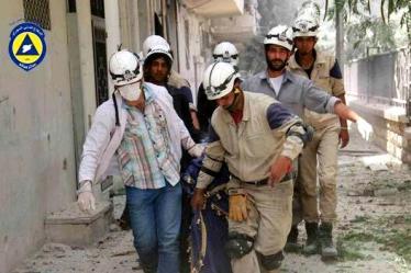 syria-civil-defense-team-aleppo-body-6-2-2014